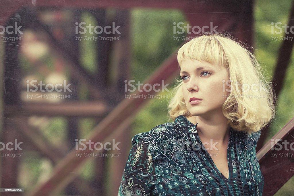 young  girl standing on bridge bearing royalty-free stock photo