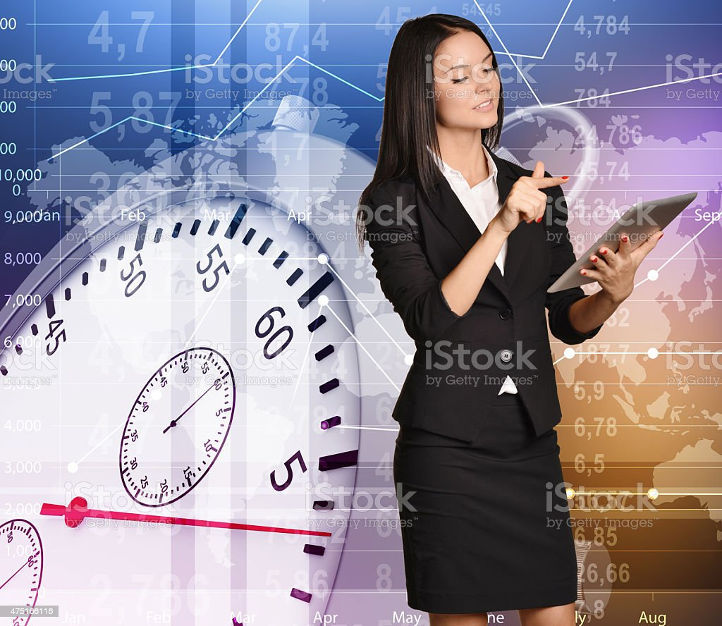 Young girl stands on background stopwatch pressing touch forefinger in stock photo