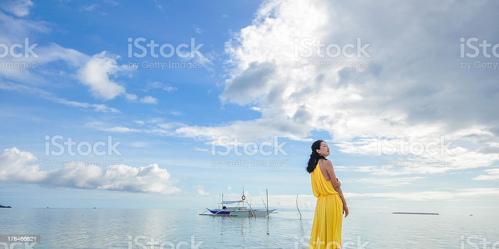 young girl stands on beach royalty-free stock photo