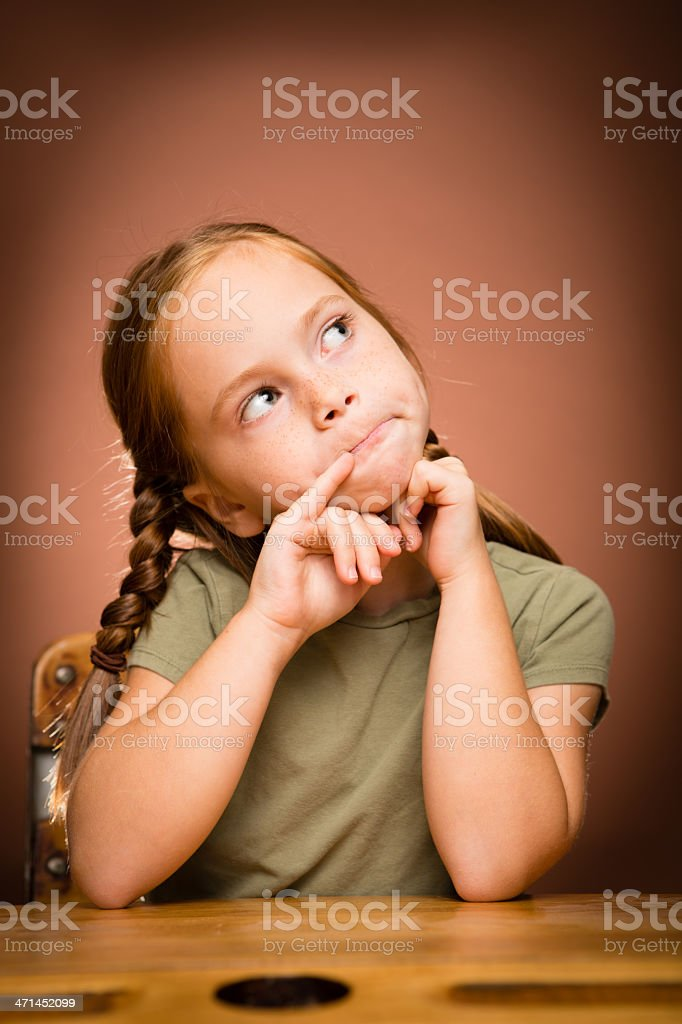 Young Girl Student Daydreaming at School Desk royalty-free stock photo