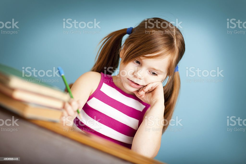 Young Girl Student Sitting at School Desk royalty-free stock photo