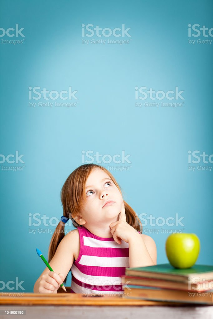 Young Girl Student Thinking in School Desk royalty-free stock photo