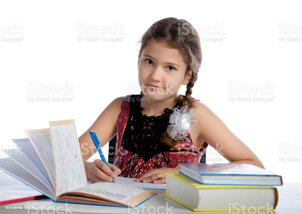 Young girl studying at the desk royalty-free stock photo