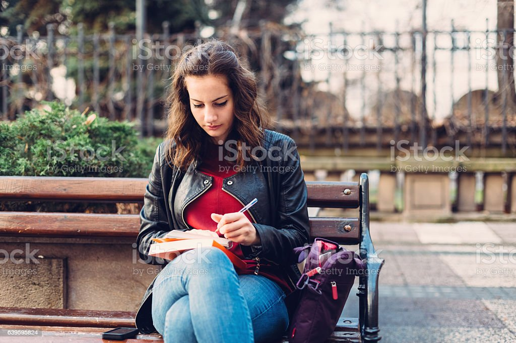 Young girl studying outside stock photo