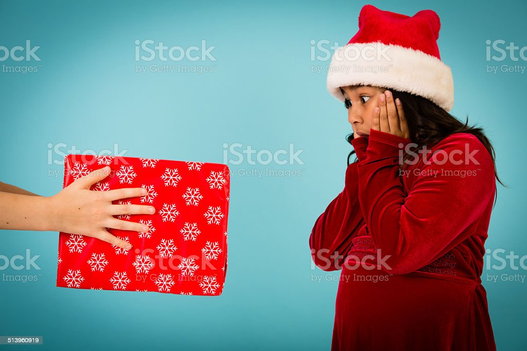 Young Girl Surprised at Receiving a Christmas Present stock photo