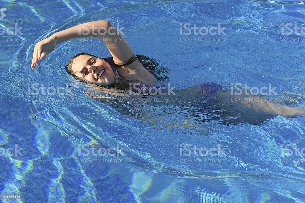 Young girl swimming royalty-free stock photo