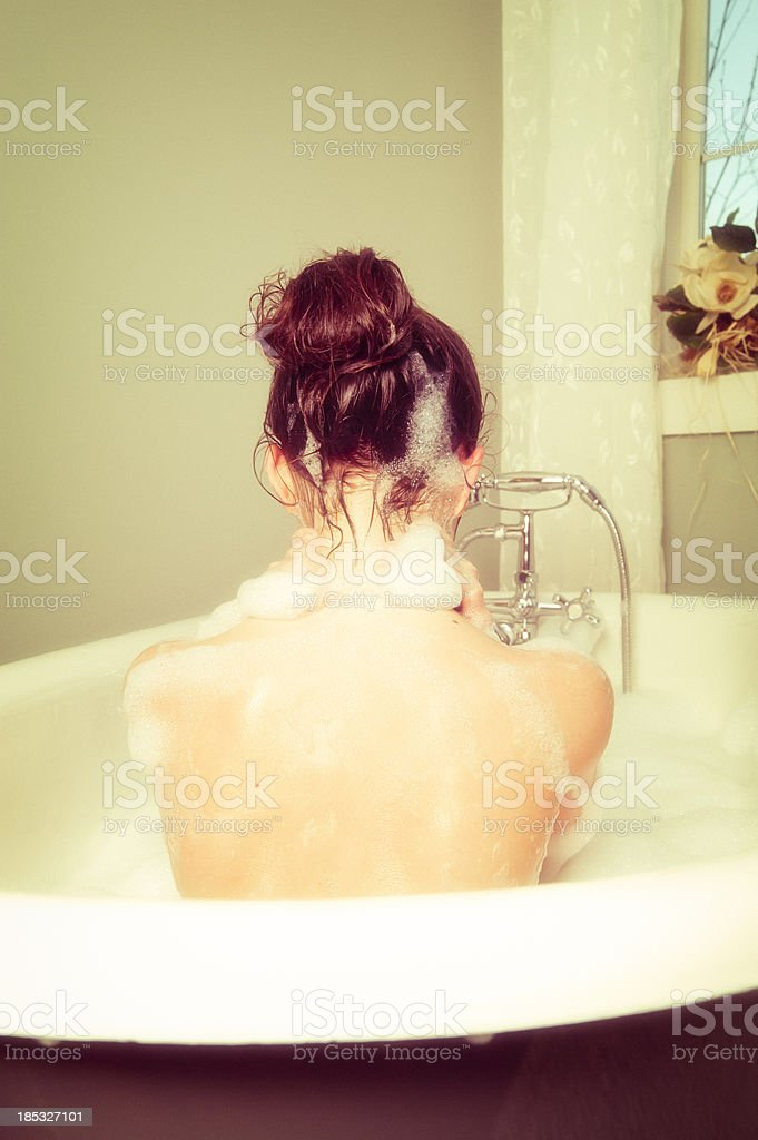 Young girl taking a bath. royalty-free stock photo