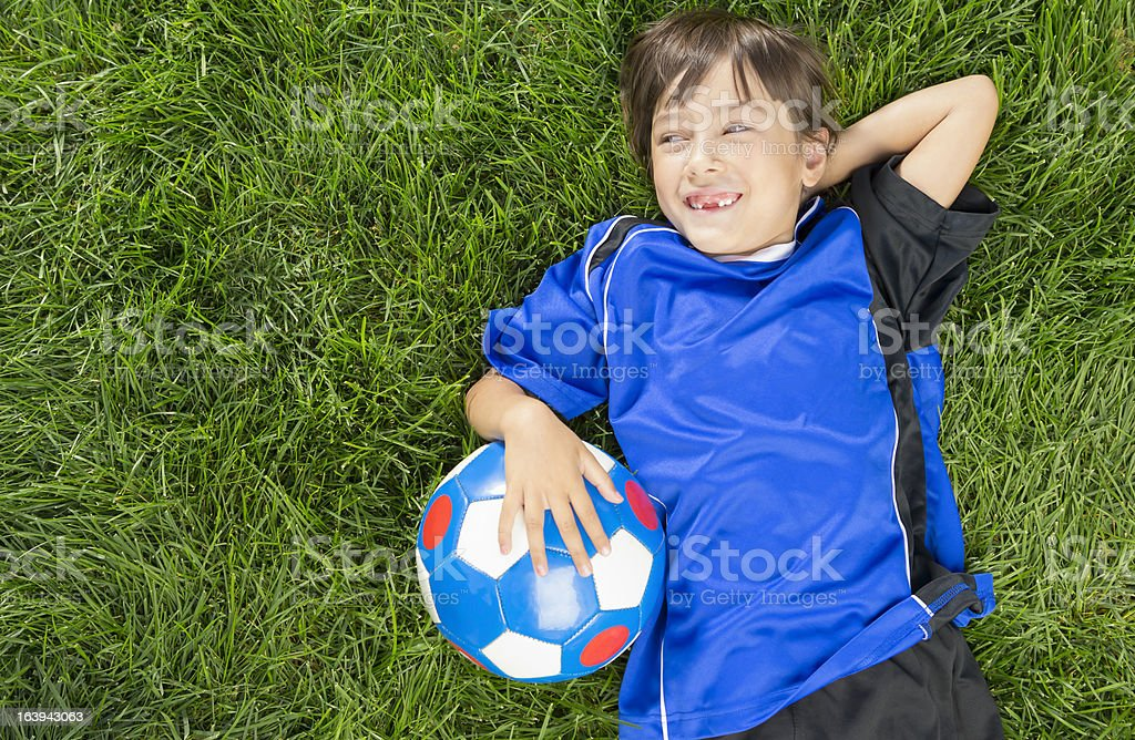Young girl taking a break from soccer royalty-free stock photo