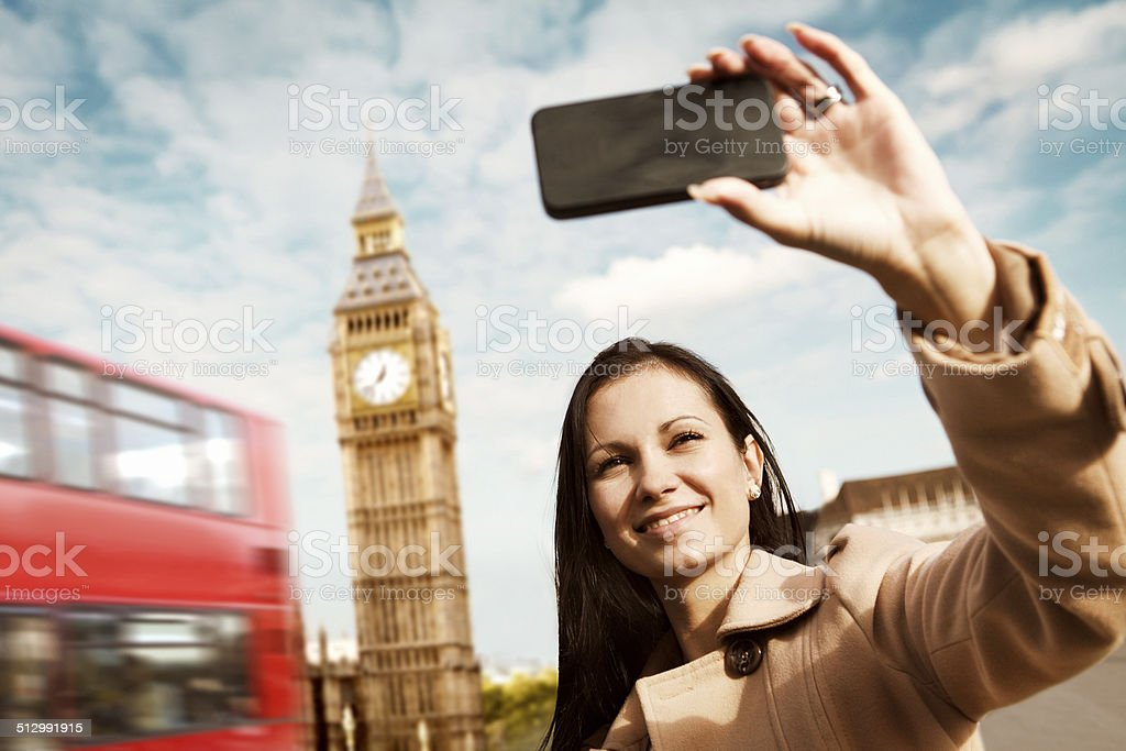 Young girl taking a selfie at Big Ben in London stock photo
