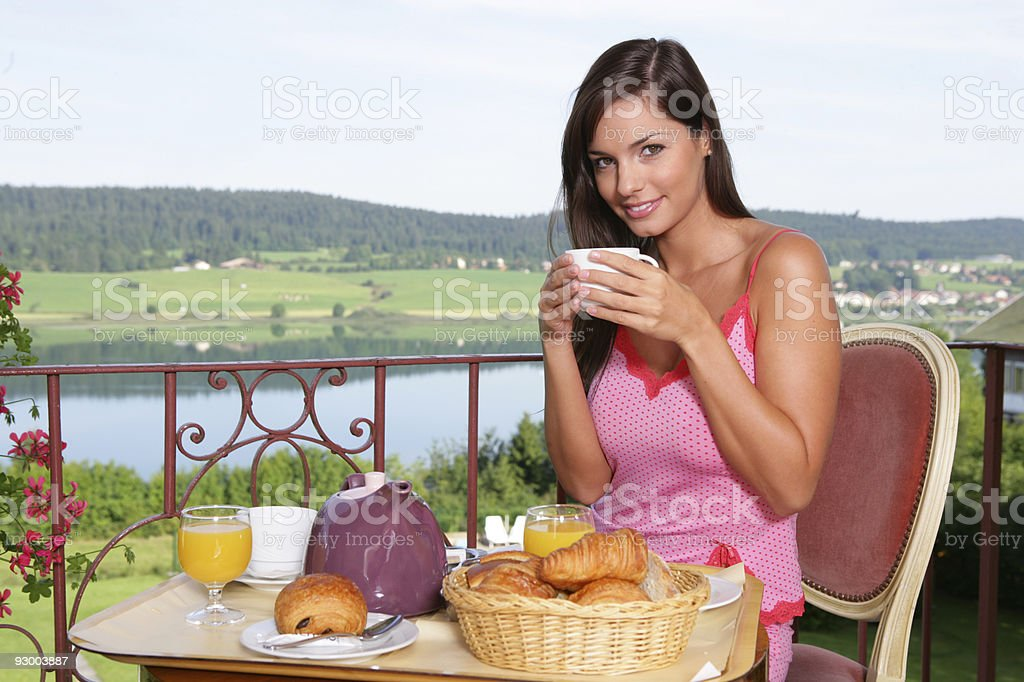 Young girl taking breakfast stock photo