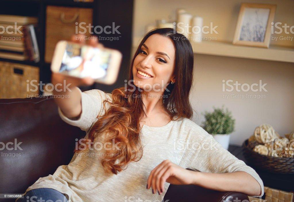 young girl taking selfie smartphone stock photo