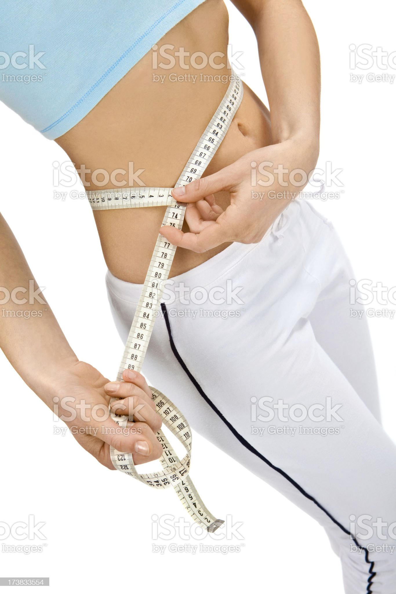 young girl tape measuring abdomen to lose weight royalty-free stock photo