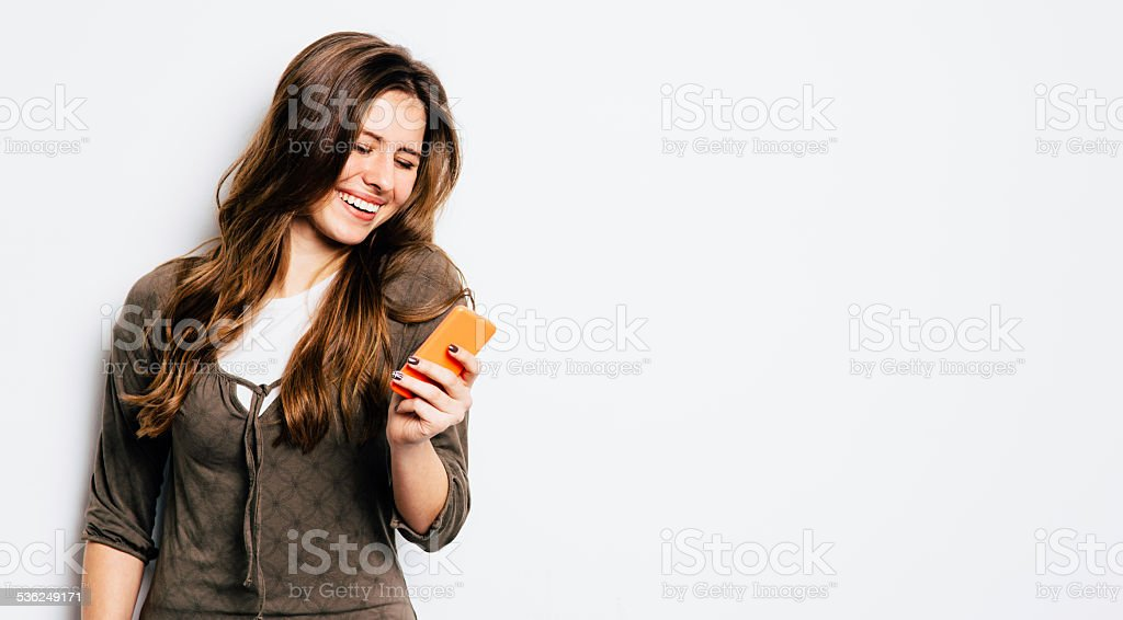 Young girl texting stock photo