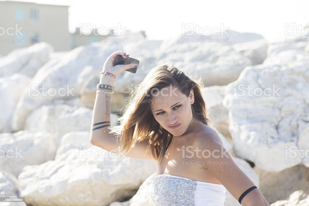 young girl throwing her smartphone away royalty-free stock photo