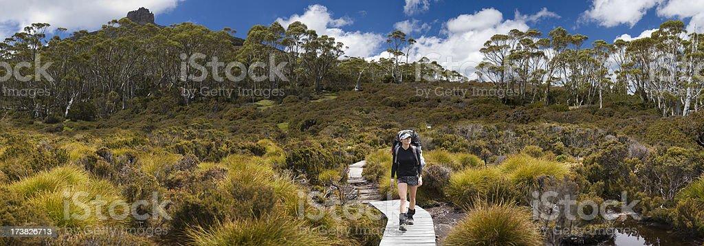 Young girl trekking through the mountain valley royalty-free stock photo