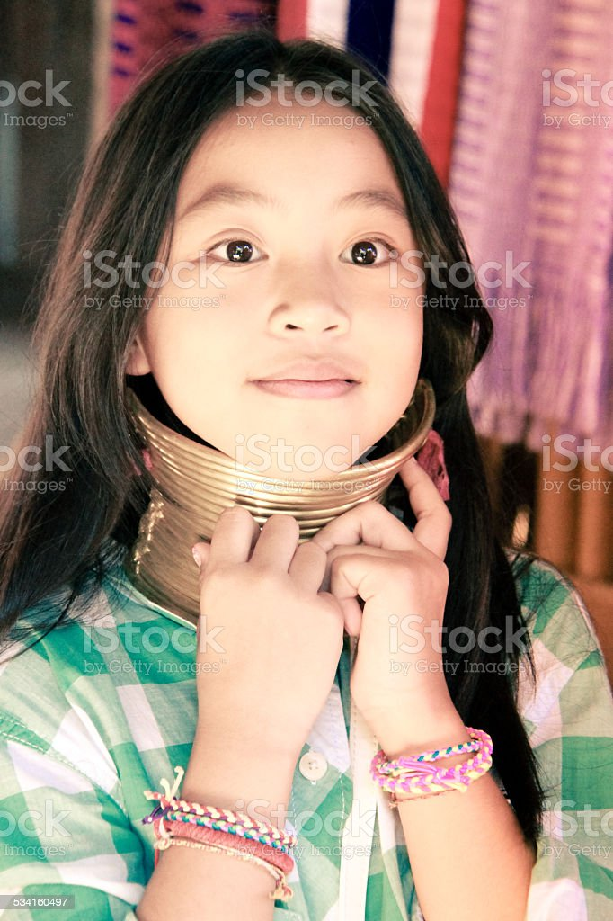 Young girl try to use  Karen Long Neck stock photo