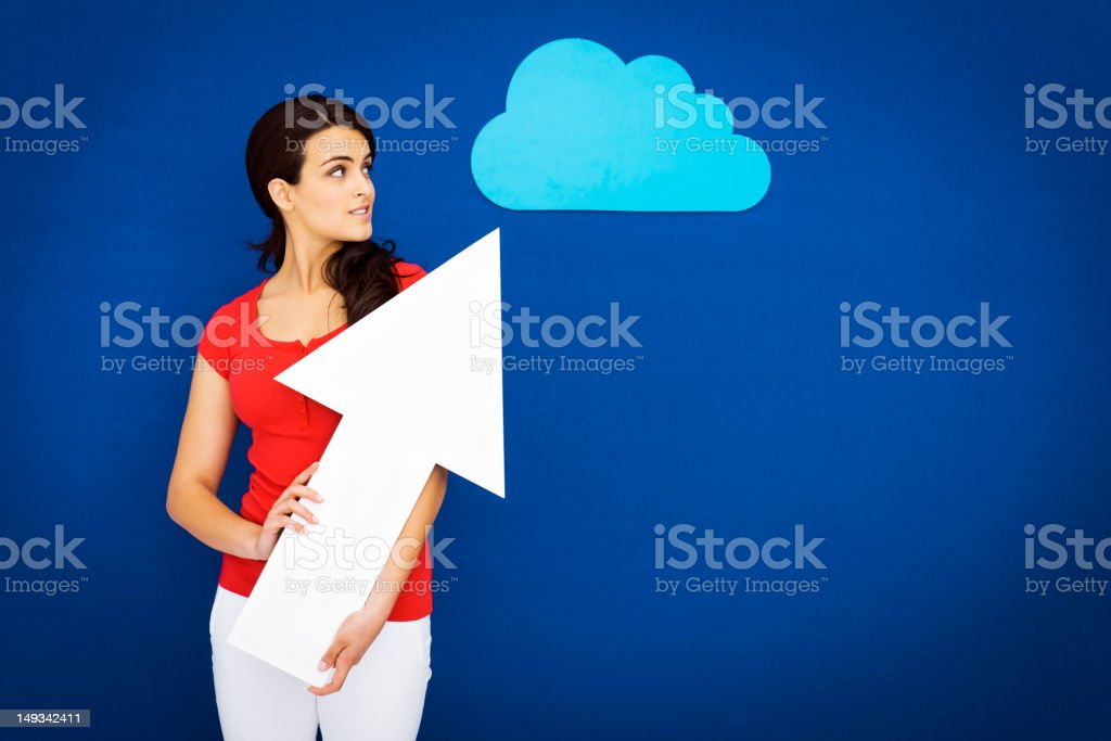 Young girl uploading to the cloud stock photo