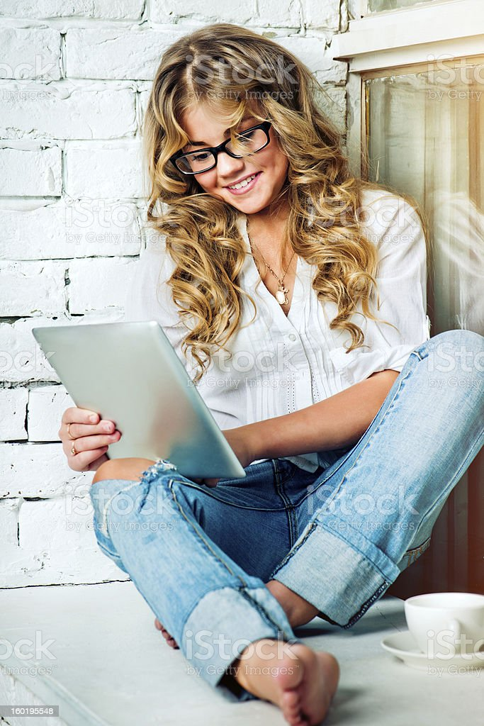 Young girl using digital tablet royalty-free stock photo