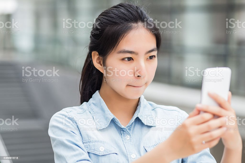 Young Girl Using Phone stock photo