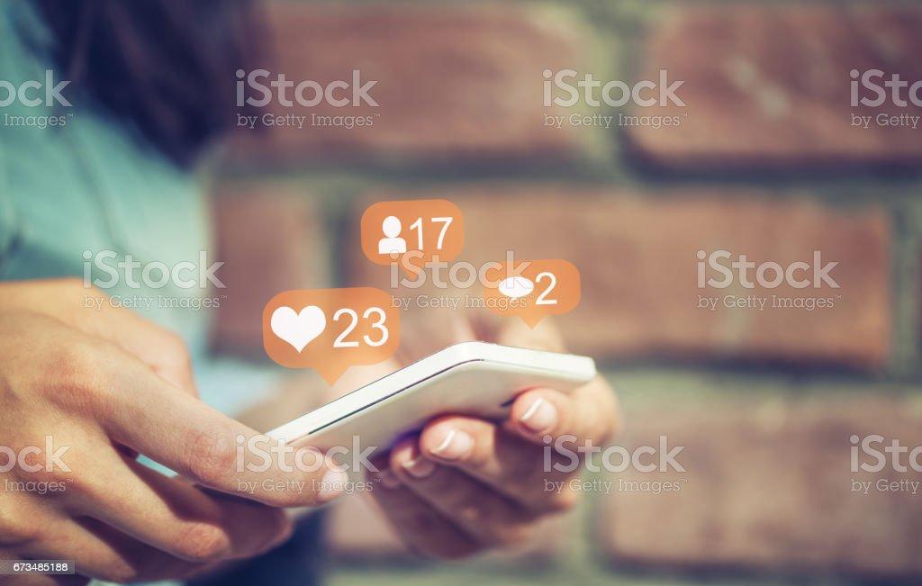 Young girl using smart phone,Social media concept. stock photo