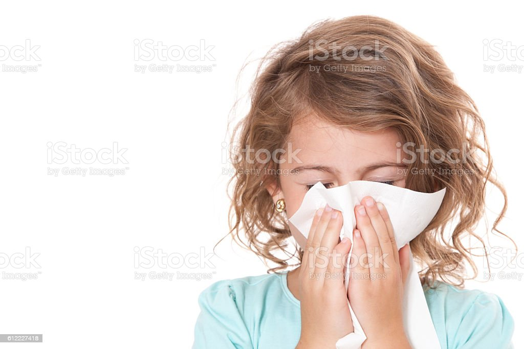 Young girl using tissue stock photo