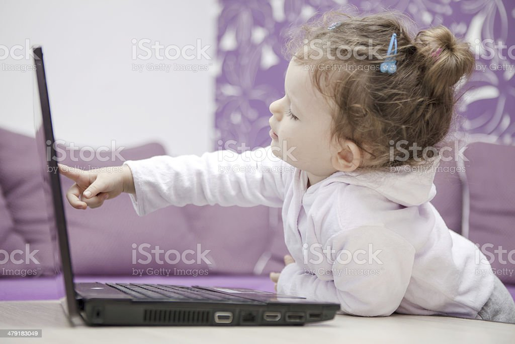 Young girl using/watching laptop stock photo