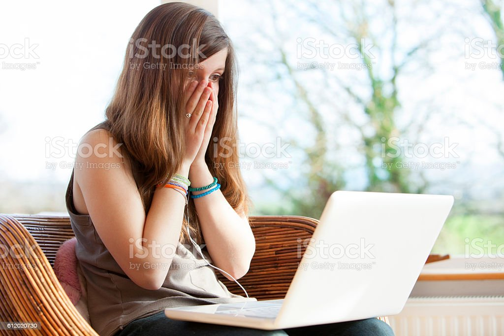 Young girl victim of cyber bullying stock photo