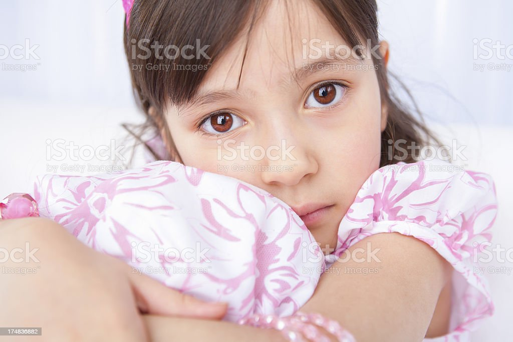 Young girl waiting nervously for her birthday party to begin royalty-free stock photo