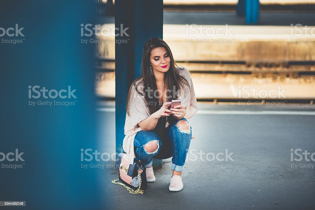 young girl waiting the train stock photo