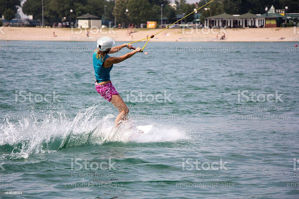 Young girl wakeboarder stock photo