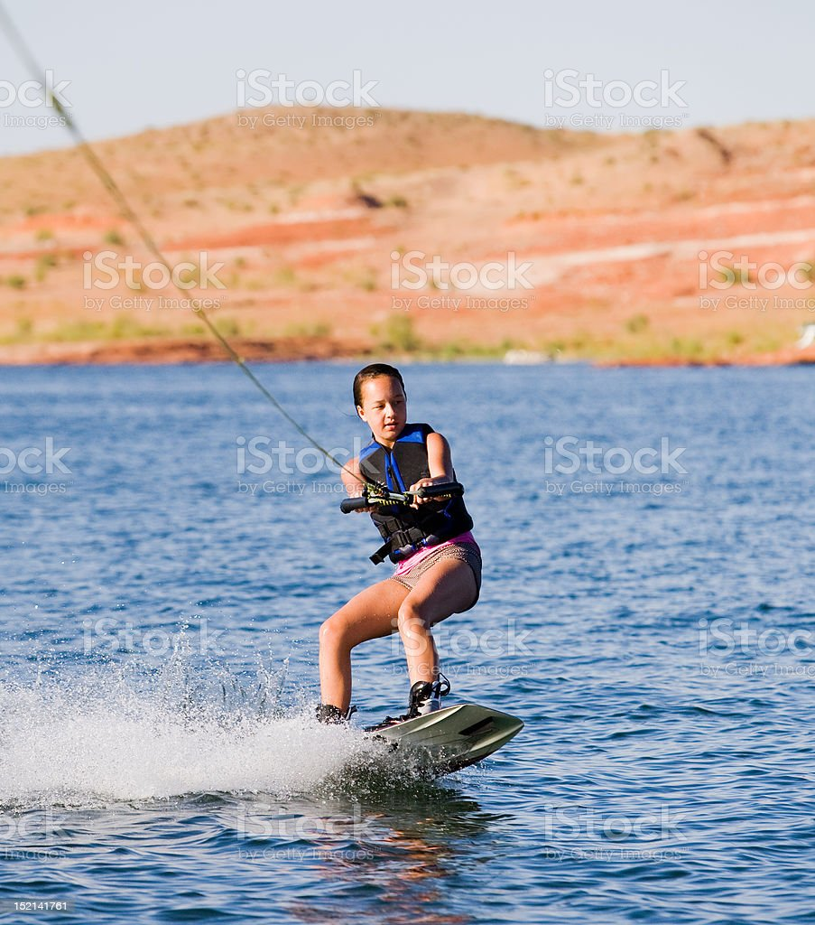 Young Girl wakeboarding at Lake Powell royalty-free stock photo