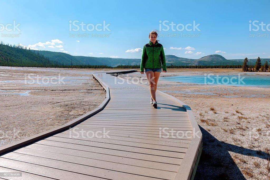 Young girl walking , Grand Prismatic Lake in Yellowstone ,Wyoming, USA stock photo