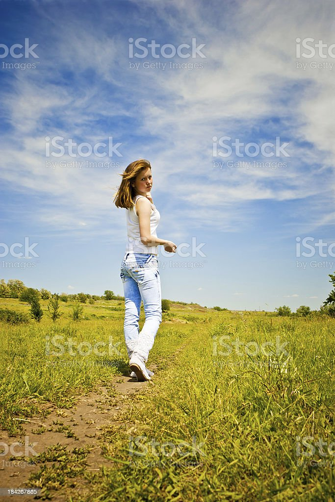 Young girl walking on a meadow royalty-free stock photo