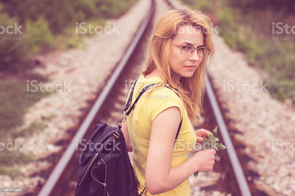 Young girl walking on stripe stock photo