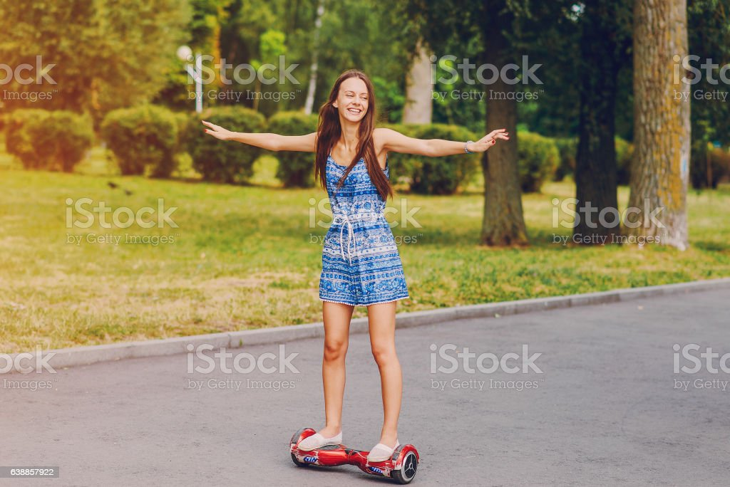 young girl walking park stock photo
