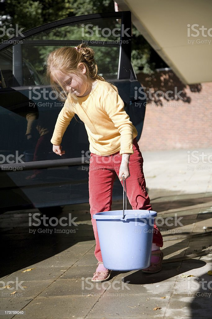 Young girl washing a car royalty-free stock photo