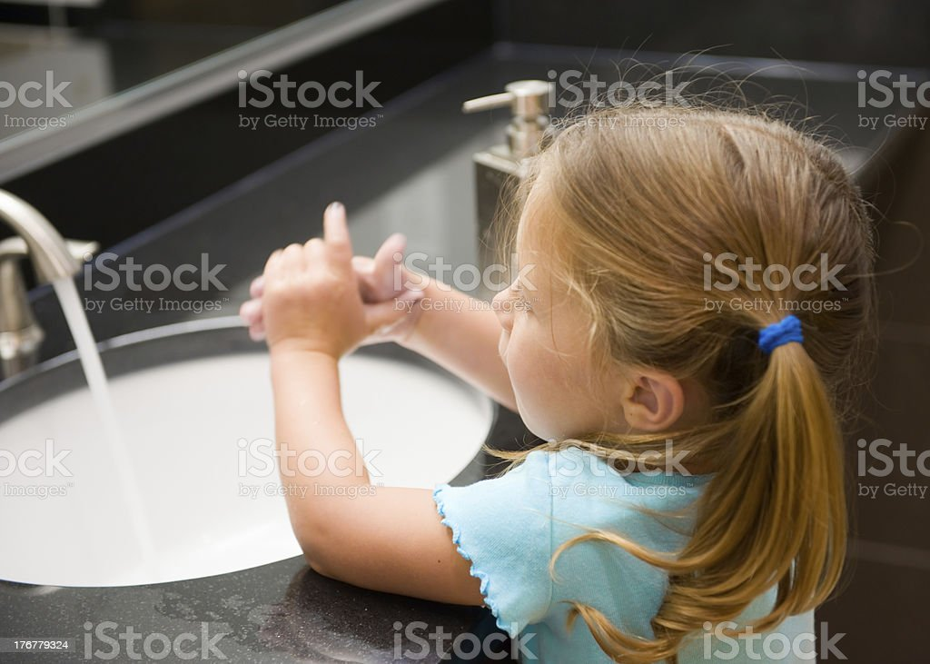 Young Girl Washing Hands royalty-free stock photo