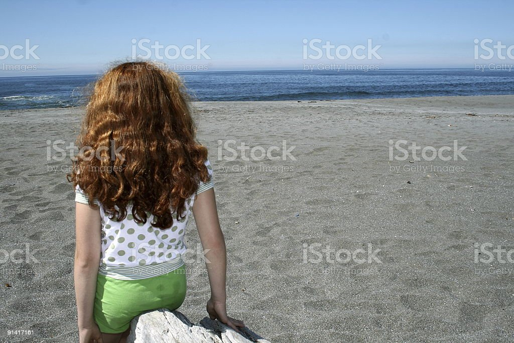 Young Girl Watching the Ocean stock photo