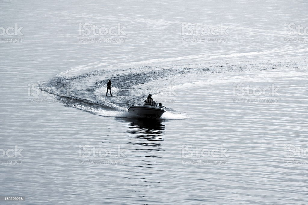 Young girl waterskiing by dusk on lake Garda in Italy stock photo