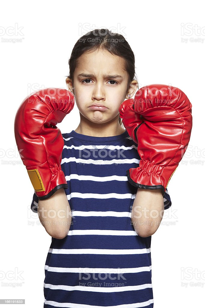 Young girl wearing boxing gloves sad and upset royalty-free stock photo
