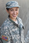 Young girl wearing green military style outfit