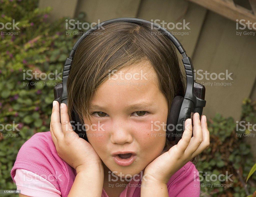 Giovane ragazza con le cuffie foto stock royalty-free