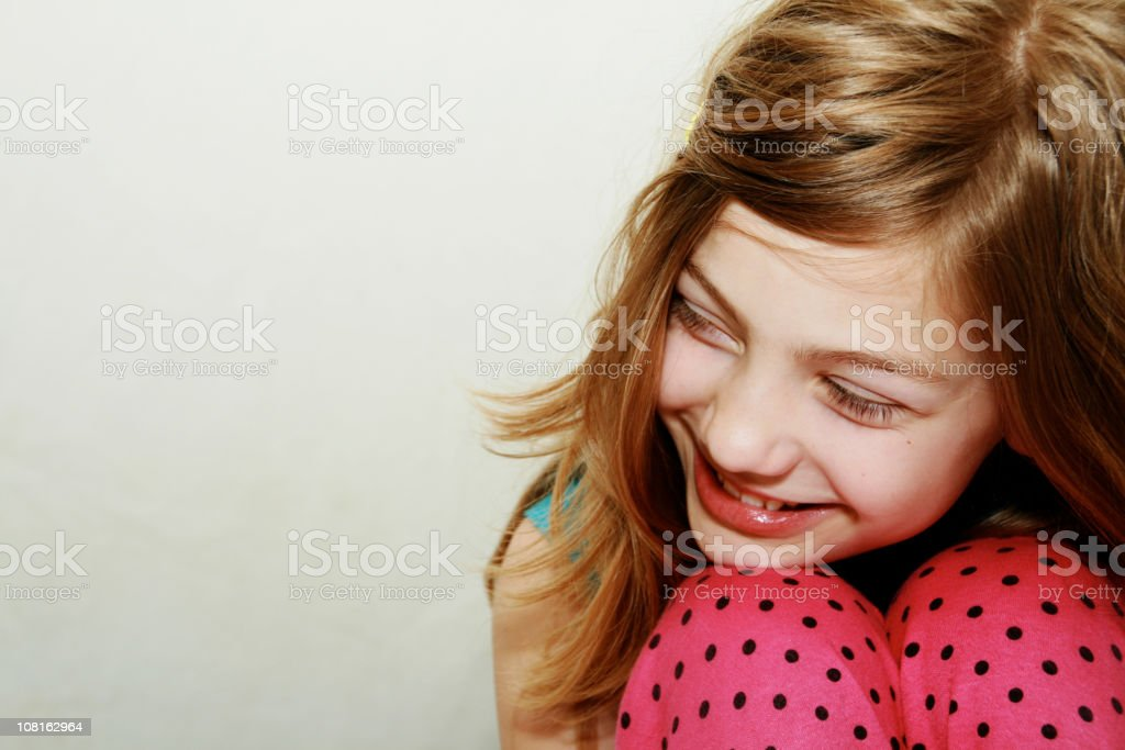 Young Girl Wearing Pink Polka Dotted Pants Smiling stock photo