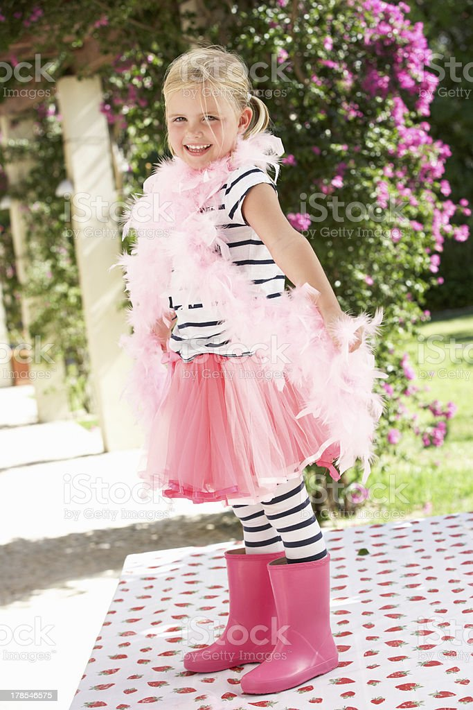 Young Girl Wearing Pink Wellington And Feather Boa stock photo