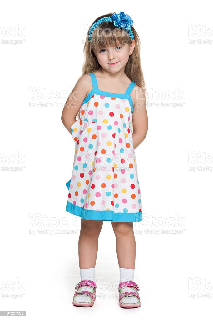 Young girl wearing polka dot dress stock photo