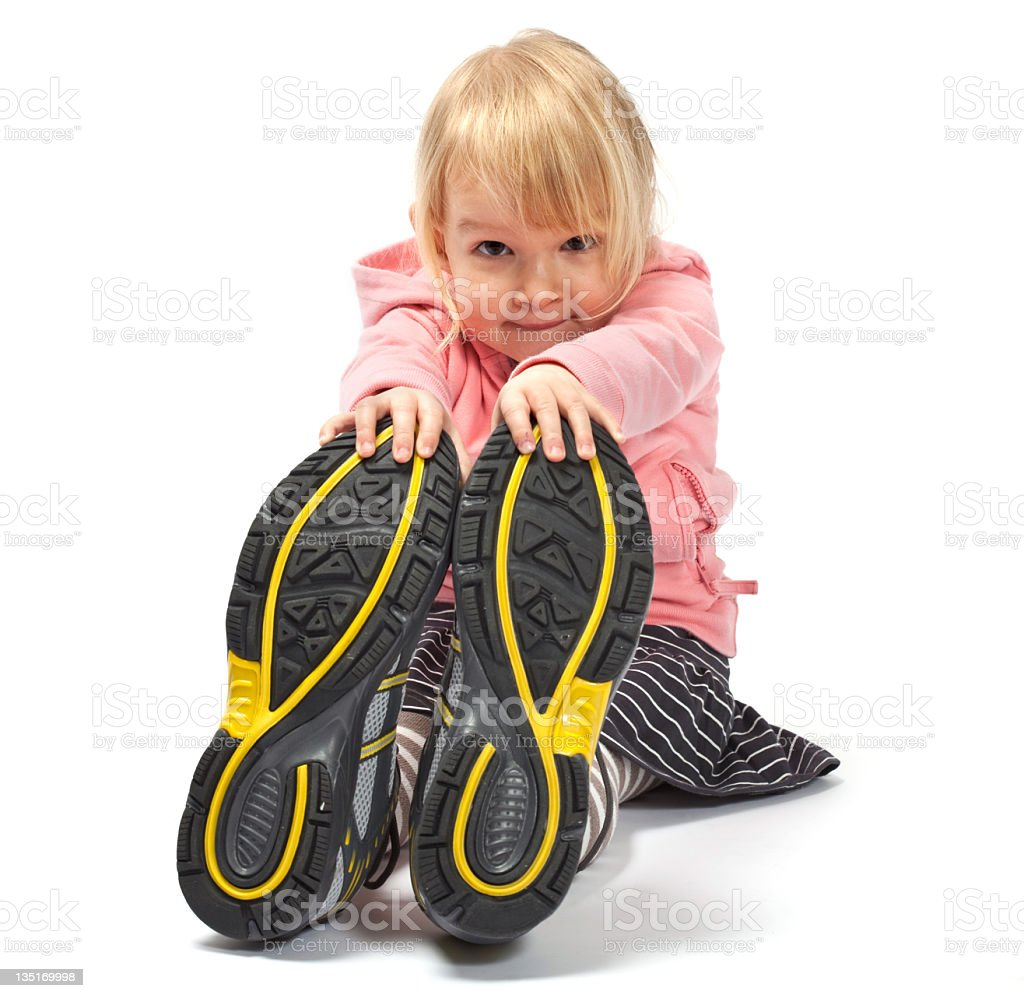 Young girl wearing sports shoes stock photo