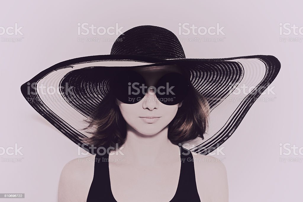 Young girl wearing summer hat stock photo