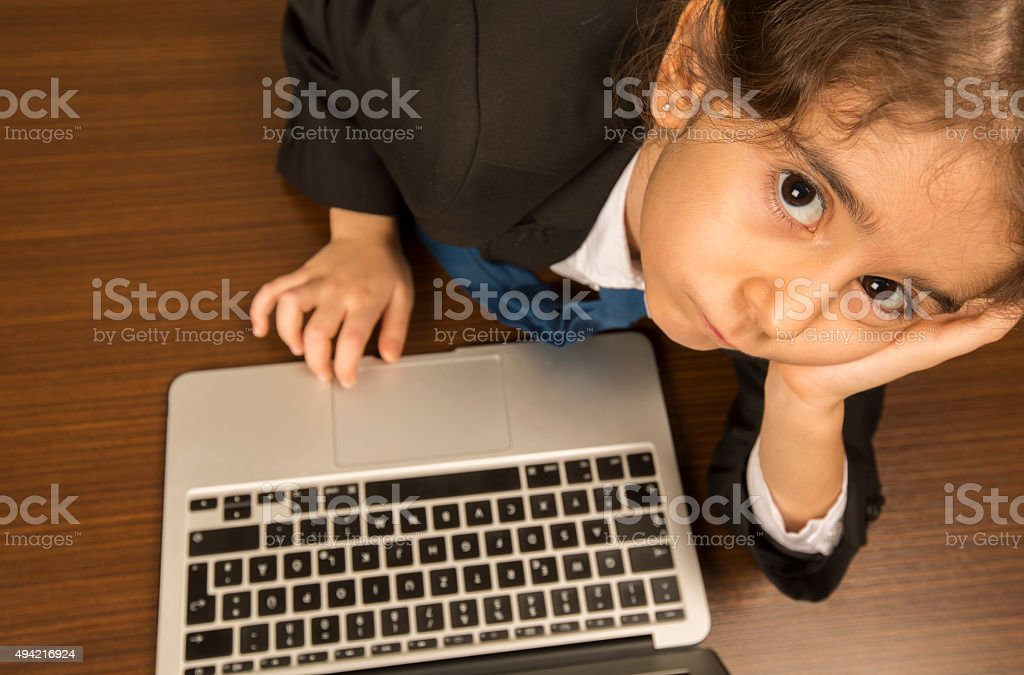 Young Girl Wearing Tie Types On Laptop stock photo 494216924