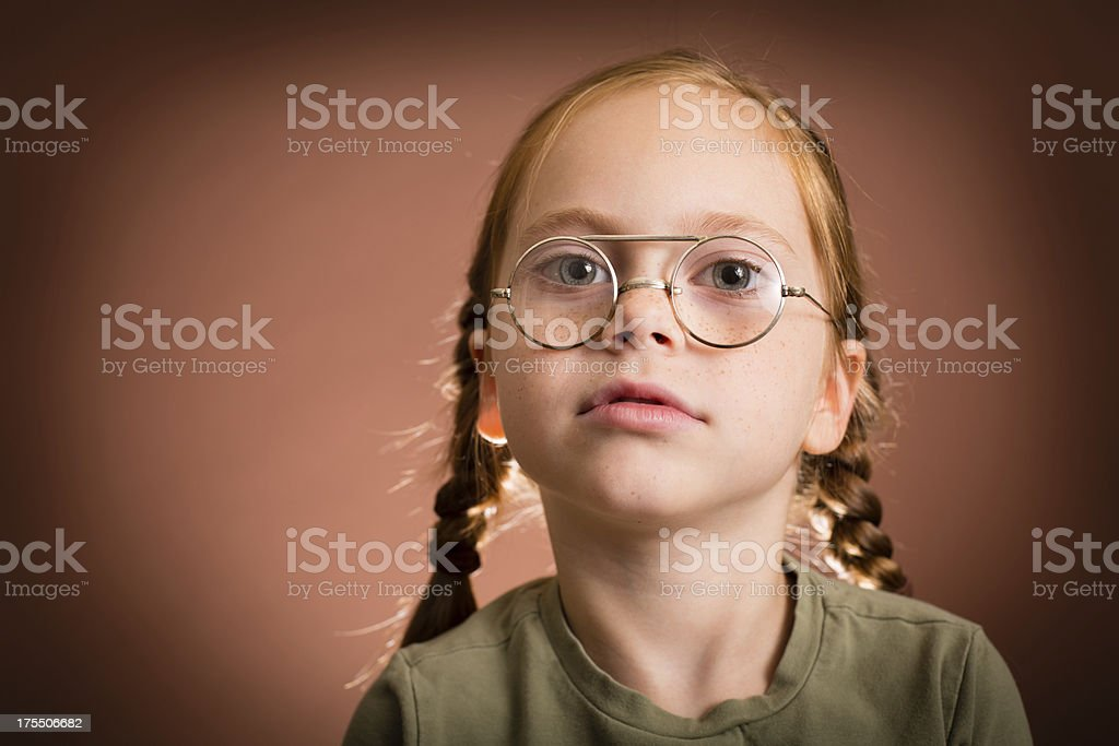 Young Girl Wearing Vintage, Nerdy Eyeglasses royalty-free stock photo