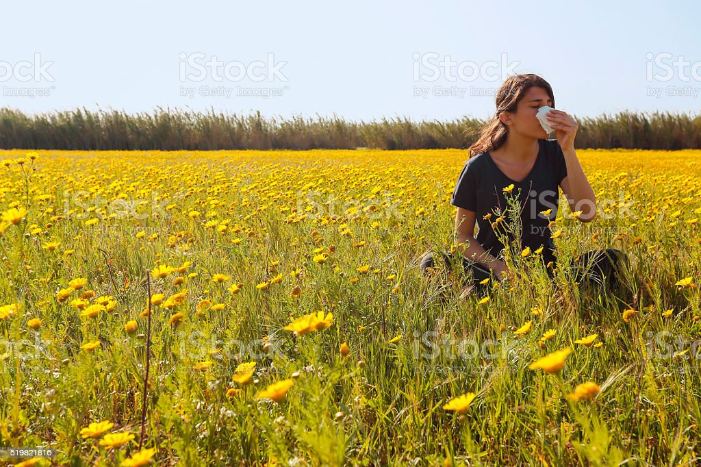 Young girl who is allergic to flowers. stock photo